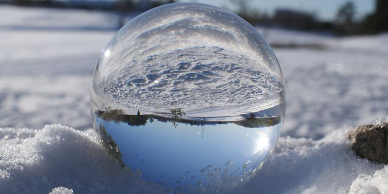 Lens ball view of a wintery landscape.